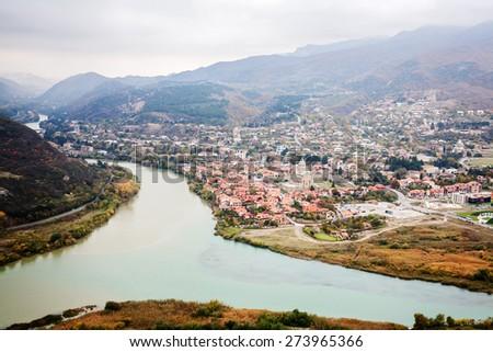 Panoramic view of Mtskheta town from Jvari monastery in  Georgia - stock photo
