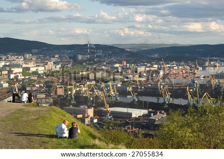 panoramic view of Murmansk with resting people - stock photo