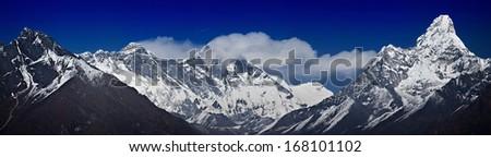 Panoramic view of Nepalese Himalayas in Solukhumbu District (Sagarmatha National Park): Khumbi Yul Lha 5,761 m., Nuptse peaks 7,695-7,861m., Everest 8,848 m., Lhotse 8,516 m., Ama Dablam 6,856 m. - stock photo