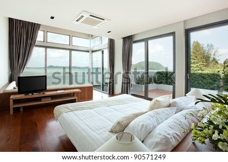 panoramic view of nice cozy  bedroom  with  summer  outdoor.