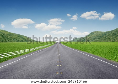 panoramic  view of nice summer empty road  through the mountain