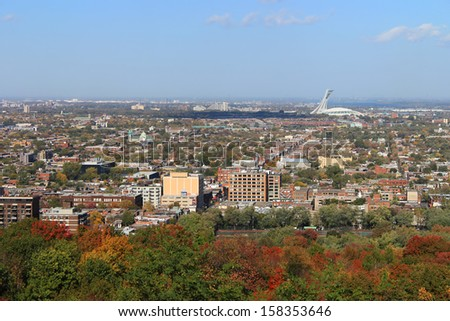 Panoramic view of North Montreal, Quebec, Canada during Autumn or Fall season with Olympic Stadium in the background  - stock photo