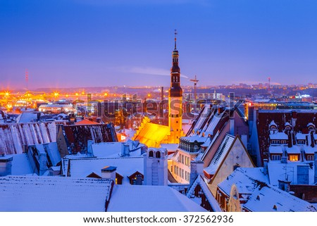 Panoramic view of old part of Tallinn in winter. Snowy roofs - stock photo