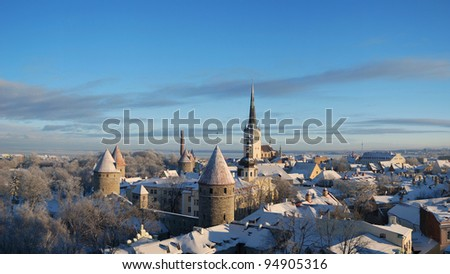 Panoramic view of old part of Tallinn Lower Town in winter - stock photo