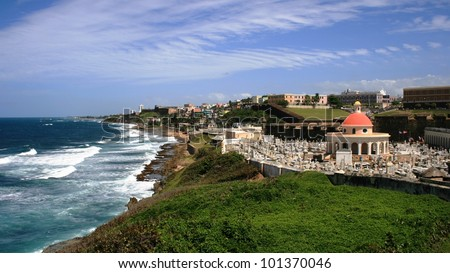 Panoramic view of Old San Juan, Puerto Rico, with ocean, buildings and sky - stock photo