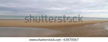 Panoramic view of Omaha Beach in Normandy, France at low tide