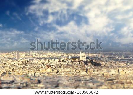 Panoramic view of Paris, with Sacre Coer Basilic captured with small depth of field - stock photo