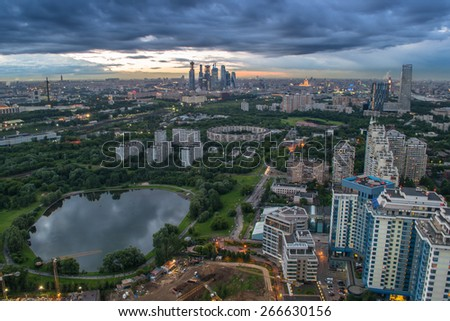 Panoramic view of park, pond, residential district in Moscow, Russia during cloudy summer day.  - stock photo