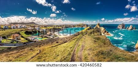Panoramic view of Playa de la Arnia, rocky dramatic coastline in Santander ,Cantabria, Spain. - stock photo