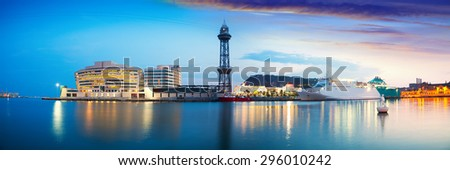 Panoramic view of Port Vell with liner in evening. Barcelona - stock photo