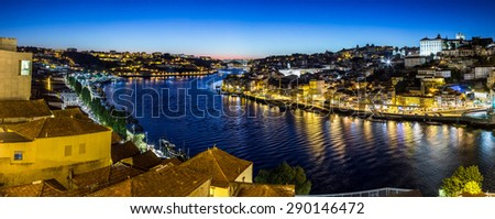 Panoramic view of Porto and the Dom Luiz bridge in Portugal at night