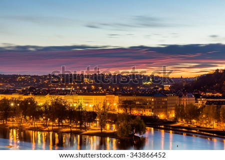 Panoramic view of Prague over Vltava river from the Charles bridge tower at sunset, Czech Republic