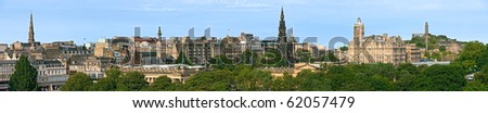 Panoramic view of Princes Street, Edinburgh, with Scott Monument, Balmoral Hotel, and Calton Hill on skyline, roofs of Royal Scottish Academy and National Gallery of Scotland in foreground. - stock photo