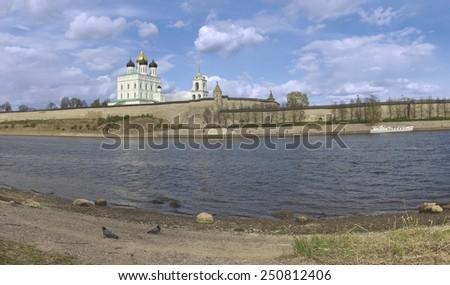 Panoramic view of Pskov Kremlin and Velikaya River in spring - stock photo