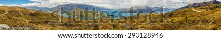 Panoramic view of Queenstown from top of Queenstown Hill in a cloudy day. We can see The Remarkables mountain and Lake Wakatipu. - stock photo