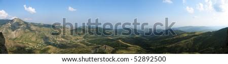panoramic view of range of hills - stock photo