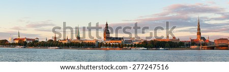 Panoramic view of Riga's old town at sunset - stock photo