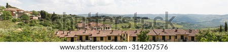 Panoramic view of rural village and vineyards of the Chianti wine region of Italy - stock photo