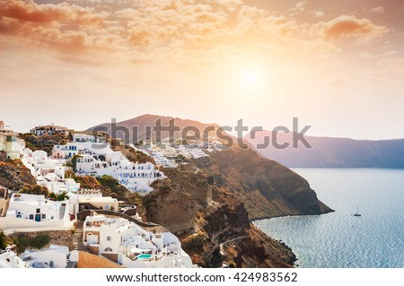 Panoramic view of Santorini island, Greece at sunrise. Beautiful summer landscape with sea view. - stock photo