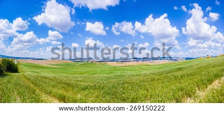 Panoramic view of scenic Tuscany landscape with rolling hills and beautiful cloudscape in Val d'Orcia, Italy - stock photo