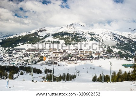 Panoramic view of Sestriere village from above, famous ski resort in the italian western Alps, Piedmont, Italy. - stock photo