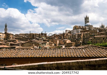 Panoramic view of Siena in Italy with beautiful clouds