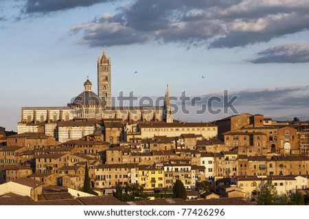 Panoramic view of Siena with the cathedral in the background - stock photo