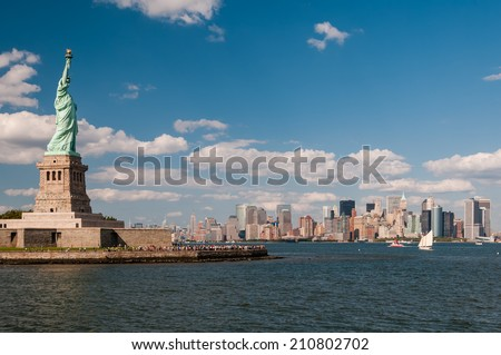 Panoramic view of Statue of Liberty and Manhattan. - stock photo