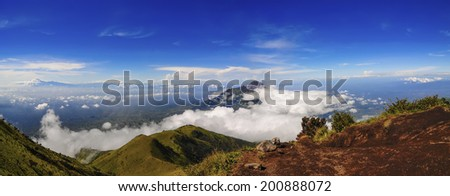 Panoramic View of stratovolcano Mount Merapi, part of the Ijen volcano complex in Eastern Java, Indonesia - stock photo