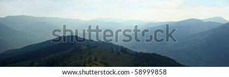 Panoramic view of summer mountains in evening. Carpathians, Ukraine