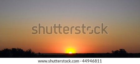 Panoramic view of sunset over rural landscape. Horizontal shot. - stock photo