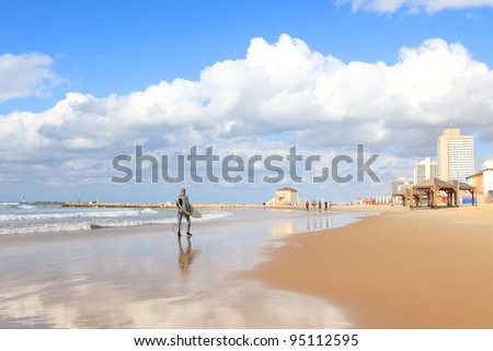 Panoramic view of Tel-Aviv beach and men going to surfing. Mediterranean sea. Israel - stock photo