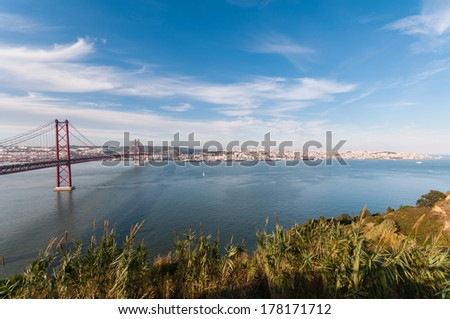 Panoramic view of 25th of April Suspension Bridge in Lisbon, Portugal. - stock photo