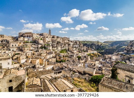 Panoramic view of the ancient town of Matera (Sassi di Matera), European Capital of Culture 2019, in beautiful golden morning light with blue sky and clouds, Basilicata, southern Italy - stock photo