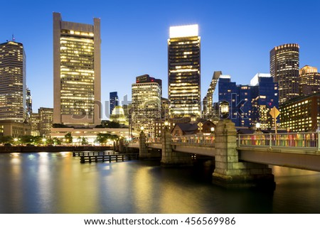 Panoramic view of the Boston Harbor and Financial District in Boston, Massachusetts, USA at sunset. - stock photo