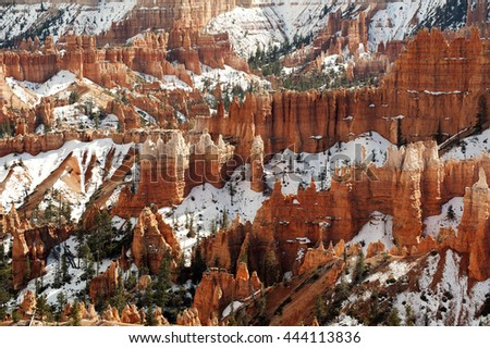 Panoramic view of the Bryce Canyon with a dramatic sky and snow covered cliffs. Bryce Canyon National Park, Utah, USA. - stock photo