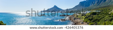 Panoramic view of the Camps Bay, Lion`s head peak and Twelve apostles mountain chain in Cape Town, South Africa - stock photo