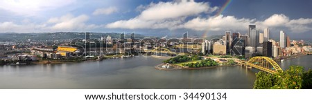 Panoramic view of the city of Pittsburgh with rainbow in late afternoon - LARGE - stock photo
