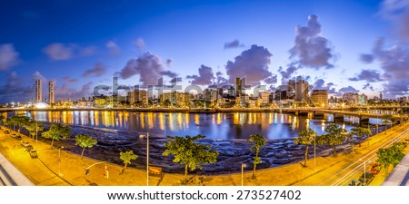 Panoramic view of the city of Recife in Pernambuco, Brazil at sunset showcasing its mix historic and modern architecture and the Capibaribe river cross it on s warm summer day. - stock photo
