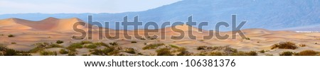 Panoramic view of the dunes at Mesquite dunes in Death Valley National Park at sunrise - stock photo
