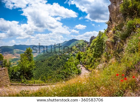 Panoramic view of the famous Lucan Dolomite mountains and historic Pietrapertosa, one of 'The most beautiful villages in Italy', in Basilicata, Italy - stock photo