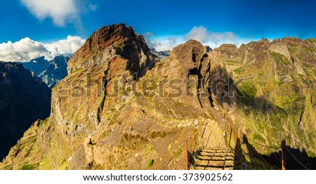 panoramic view of the footpath with steps from Pico do Arieiro towards Pico Ruivo, Madeira, Portugal