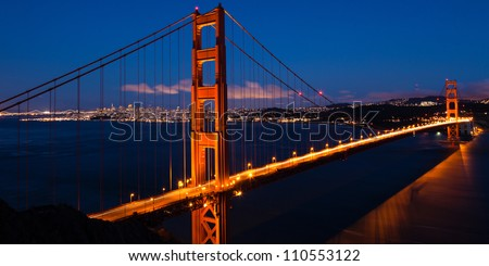 Panoramic view of the  Golden Gate bridge by night in San Francisco - USA - stock photo