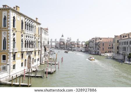 Panoramic view of the Grand Canal and Santa Maria della Salute from the Accademia Bridge (Ponte dell'Accademia), Venice, Italy - stock photo