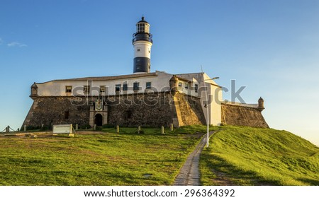 Panoramic view of the hisdtoric architecture of Farol da Barra Light House in Salvador, Bahia, Brazil on a sunny summer afternoon. - stock photo