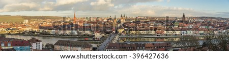 Panoramic view of the historic city of Wurzburg at dusk with Alte Mainbrucke, region of Franconia, Northern Bavaria, Germany - stock photo