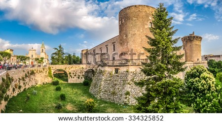 Panoramic view of the historic town of Venosa with famous Aragonese Castle (Castello Aragonese) in golden evening light, Basilicata, southern Italy - stock photo