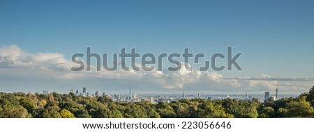 Panoramic view of the London skyline seen from Hampstead Heath - stock photo