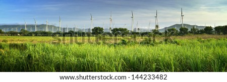 Panoramic view of the modern Windmills on a background of mountains in Mexico - stock photo
