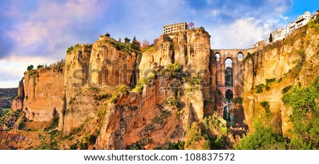 Panoramic view of the old city of Ronda, one of the famous white villages, at sunset in the province of Malaga, Andalusia, Spain - stock photo